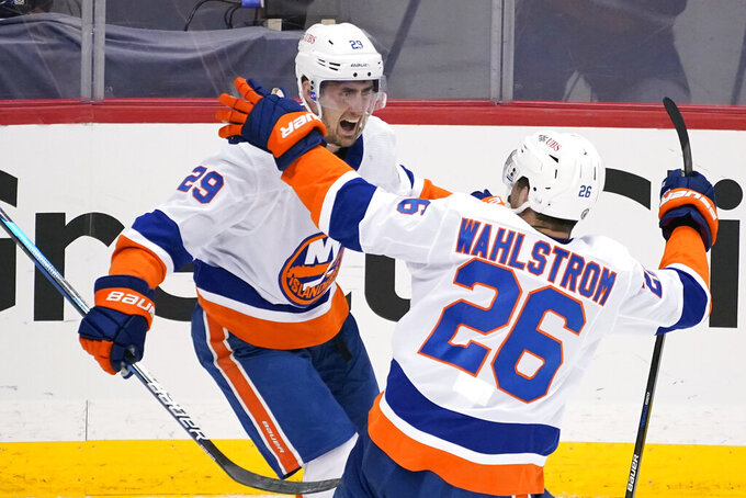 New York Islanders' Brock Nelson (29) celebrates after scoring during the third period in Game 1 of an NHL hockey Stanley Cup first-round playoff series against the Pittsburgh Penguins in Pittsburgh, Sunday, May 16, 2021. The Islander won in overtime 4-3. (AP Photo/Gene J. Puskar)