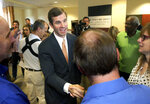 Kentucky Attorney General Andy Beshear shakes hands with supporters before announcing his campaign for governor Monday, July 9, 2018, in Louisville, Ky. Beshear announced Monday he will seek the Democratic nomination for governor in 2019. He is the first candidate to formally enter the race, as Republican Gov. Matt Bevin has not said whether he will seek re-election. (Robin Cornetet/Kentucky Today via AP)