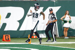 Philadelphia Eagles' J.J. Arcega-Whiteside (19) scores a touchdown during the first half of an NFL preseason football game against the New York Jets Friday, Aug. 27, 2021, in East Rutherford, N.J. (AP Photo/Noah K. Murray)