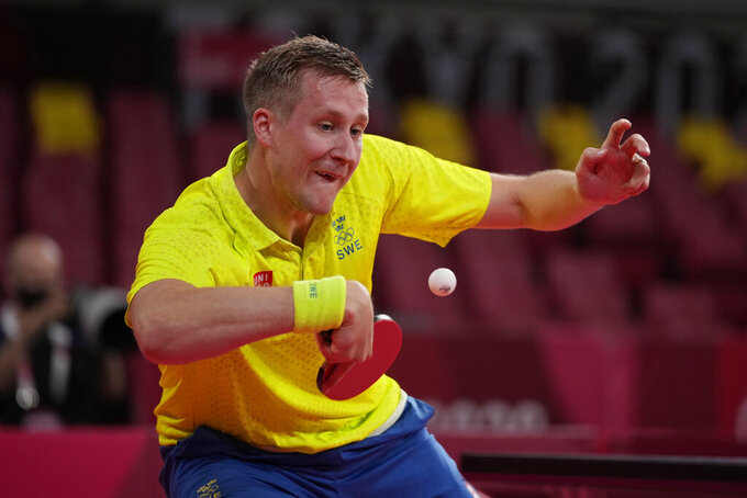 Sweden's Mattias Falck competes during the table tennis men's singles third round match against Egypt's Omar Assar at the 2020 Summer Olympics, Tuesday, July 27, 2021, in Tokyo. (AP Photo/Kin Cheung)