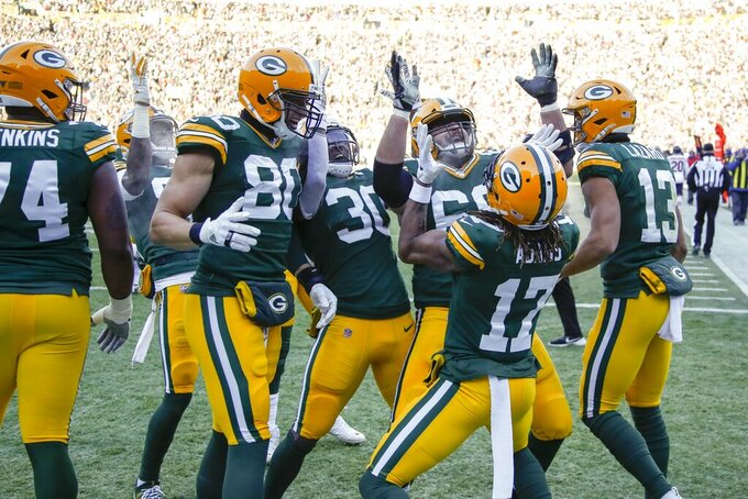 Green Bay Packers' Davante Adams celebrates his touchdown catch with teammates during the first half of an NFL football game against the Chicago Bears Sunday, Dec. 15, 2019, in Green Bay, Wis. (AP Photo/Matt Ludtke)