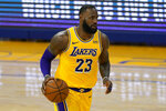 Los Angeles Lakers forward LeBron James (23) dribbles the ball up the court against the Golden State Warriors during the first half of an NBA basketball game in San Francisco, Monday, March 15, 2021. (AP Photo/Jeff Chiu)