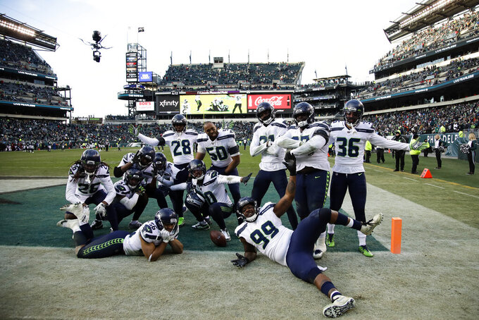Seattle Seahawks defensive players celebrate during the second half of an NFL football game against the Philadelphia Eagles, Sunday, Nov. 24, 2019, in Philadelphia. (AP Photo/Matt Rourke)