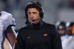 Oklahoma State coach Mike Gundy walks on the sideline during the second half of the team's NCAA college football game against Oklahoma in Norman, Okla., Saturday, Nov. 21, 2020. (AP Photo/Sue Ogrocki)