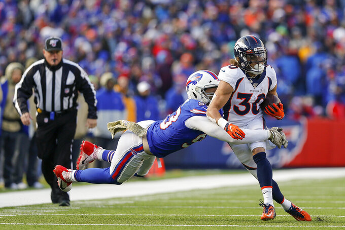 Denver Broncos running back Phillip Lindsay (30) is tackled by Buffalo Bills defensive end Trent Murphy (93) during the second quarter NFL football game, Sunday, Nov. 24, 2019, in Orchard Park, N.Y. (AP Photo/John Munson)