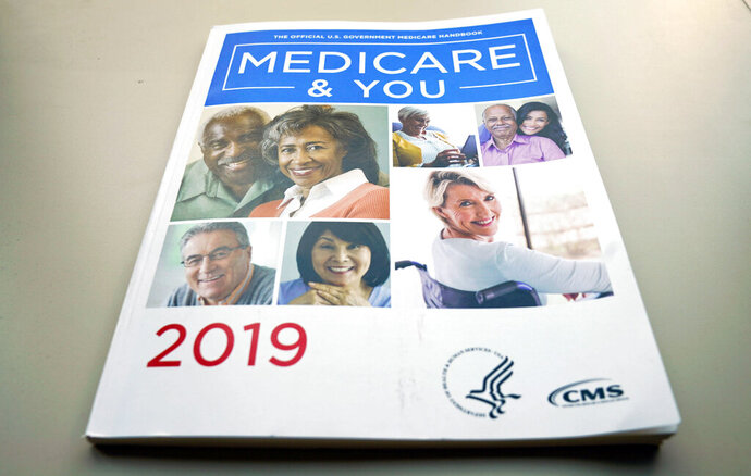 FILE - In this Nov. 8, 2018, file photo, the U.S. Medicare Handbook is photographed, in Washington. A new study finds that more than half of seriously ill Medicare enrollees _ 53% _ struggle to pay their medical bills. Prescription drugs are the leading problem. The researchers who wrote Monday's report in the journal Health Affairs were surprised by their findings, since Medicare is considered relatively good coverage.  (AP Photo/Pablo Martinez Monsivais, File)