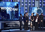 FILE - In this Jan. 28, 2018 file photo, Bruno Mars accepts the award for record of the year for