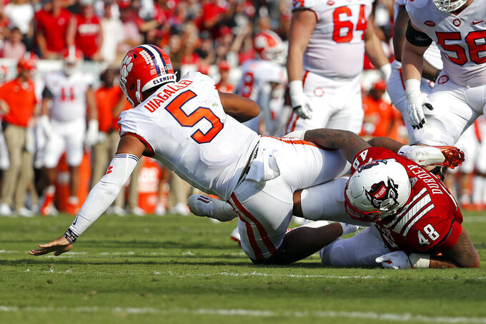 North Carolina State's Cory Durden (48) sacks Clemson's D.J. Uiagalelei (5) during the first half of an NCAA college football game in Raleigh, N.C., Saturday, Sept. 25, 2021. (AP Photo/Karl B DeBlaker)