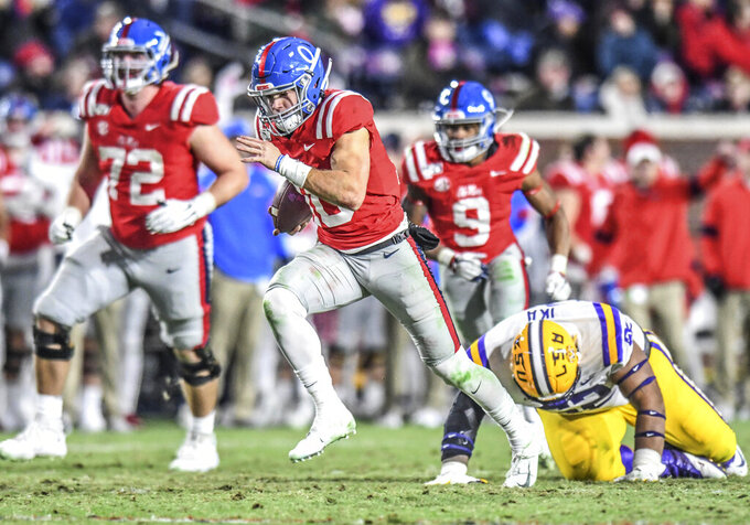Mississippi quarterback John Rhys Plumlee (10) runs past LSU nose tackle Siaki Ika (62) to score in the fourth quarter of an NCAA college football game Saturday, Nov. 16, 2019, in Oxford, Miss. (Bruce Newman/Oxford Eagle via AP)