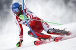 Austria's Marco Schwarz speeds down the course during an alpine ski, men's World Cup slalom, in Lenzerheide, Switzerland, Sunday, March 21, 2021. (AP Photo/Gabriele Facciotti)
