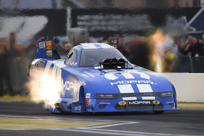 In this photo provided by the NHRA, Matt Hagan powers his Funny Car to the provisional top spot Friday, Feb. 21, 2020, at the NHRA Arizona Nationals drag races in Chandler, Ariz. (Marc Gewertz/NHRA via AP)
