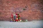 A memorial for James Scurlock sits near 12th and Harney Streets Tuesday, Sept. 15, 2020 in Omaha, Neb.. Charges were filed Tuesday against Jake Gardner, who shot Scurlock on May 30.  (Chris Machian/Omaha World-Herald via AP)