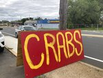 A hand-painted sign attracts passing drivers at the grand opening of the Crab Cravers food truck in Wilmington, Delaware, on Sunday, July 18, 2021. (José Ignacio Castañeda /The News Journal via AP)