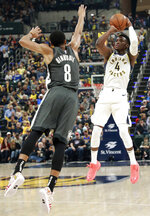 Indiana Pacers guard Victor Oladipo (4) shoots the basketball defended by Brooklyn Nets guard Spencer Dinwiddie in the first half of an NBA basketball game, Saturday, Oct. 20, 2018, in Indianapolis. (AP Photo/R Brent Smith)