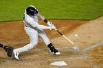 New York Yankees designated hitter Luke Voit hits a two-run home run during the eighth inning of a baseball game against the Tampa Bay Rays, Monday, Aug. 31, 2020, at Yankee Stadium in New York. (AP Photo/Kathy Willens)