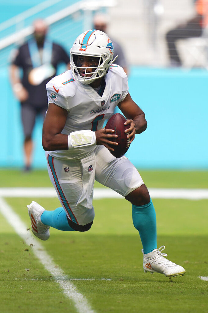 Miami Dolphins quarterback Tua Tagovailoa (1) looks to pass the ball during the first half of an NFL football game against the Los Angeles Rams, Sunday, Nov. 1, 2020, in Miami Gardens, Fla. The L.A. Chargers play at Miami on Sunday. (AP Photo/Wilfredo Lee)