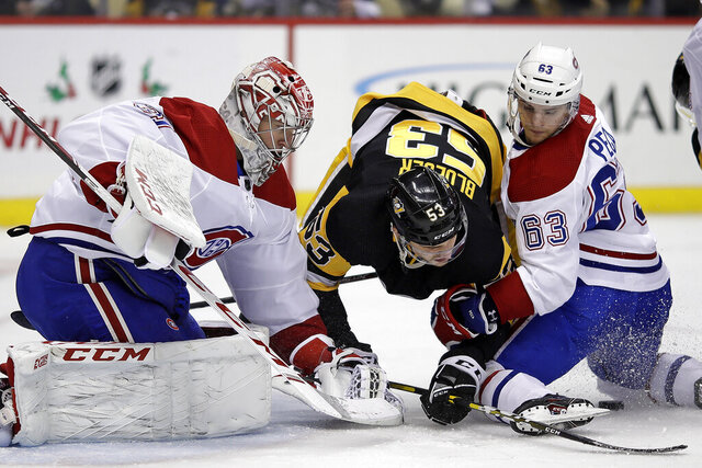Pittsburgh Penguins' Teddy Blueger (53) can't get to a rebound off Montreal Canadiens goaltender Carey Price (31) with Matthew Peca (63) defending during the second period of an NHL hockey game in Pittsburgh, Tuesday, Dec. 10, 2019. (AP Photo/Gene J. Puskar)