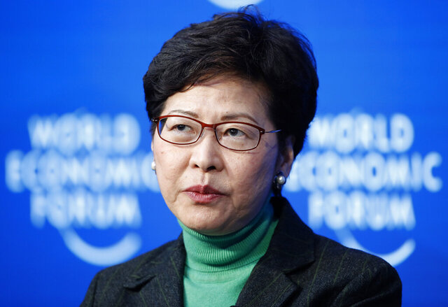 Hong Kong Chief Executive Carrie Lam takes part in a panel discussion at the World Economic Forum in Davos, Switzerland, Wednesday, Jan. 22, 2020. A preliminary test on a traveller from Wuhan China shows a positive result on the coronavirus in Hong Kong. (AP Photo/Markus Schreiber)