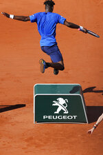 FILE - In this June 1, 2019, file photo, France's Gael Monfils jumps to avoid running into a sponsors board during his third round match of the French Open tennis tournament against France's Antoine Hoang at Roland Garros stadium in Paris. (AP Photo/Christophe Ena, File)