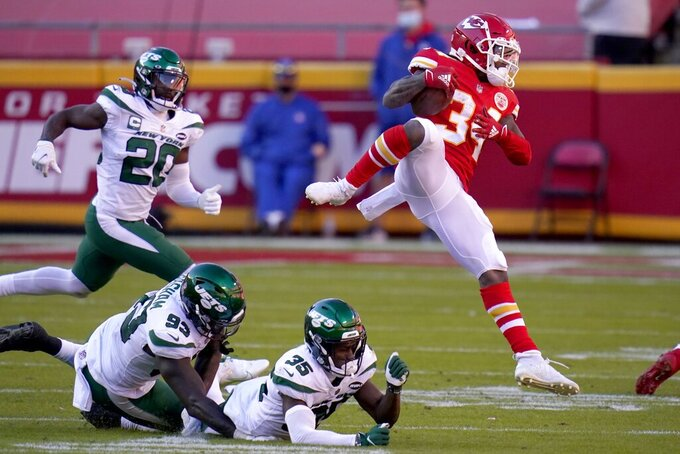 Kansas City Chiefs running back Darwin Thompson (34) leaps over New York Jets' Tarell Basham (93) and Pierre Desir (35) as Marcus Maye (20) moves to help make the stop as Thompson carries the ball in the second half of an NFL football game on Sunday, Nov. 1, 2020, in Kansas City, Mo. (AP Photo/Jeff Roberson)