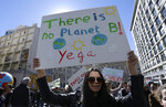 Demonstrators take part an action for the climate in Marseille, southern France, Saturday, March 16, 2019. Marches in many French cities, called