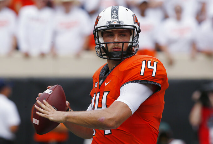 FILE - In this Sept. 15, 2018, file photo, Oklahoma State quarterback Taylor Cornelius (14) plays in an NCAA college football game against Boise State in Stillwater, Okla. Cornelius, a fifth-year senior, and Oklahoma State play at TCU this week. (AP Photo/Sue Ogrocki, File)