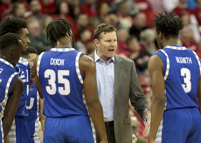Eastern Illinois head coach Jay Spoonhour instructs his players during the first half of an NCAA college basketball game against Wisconsin in Madison, Wis., Friday, Nov. 8, 2019. (John Hart/Wisconsin State Journal via AP)