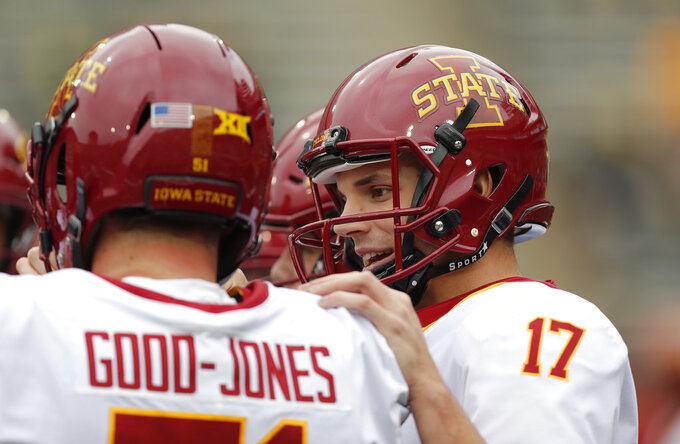 Iowa State quarterback Kyle Kempt talks with offensive lineman Julian Good-Jones before an NCAA college football game, Saturday, Sept. 8, 2018, in Iowa City, Iowa. (AP Photo/Matthew Putney)