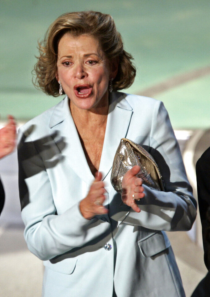 """FILE - Actress Jessica Walter applauds after """"Arrested Development"""" wins for outstanding comedy series during the 56th Annual Primetime Emmy Awards on Sept. 19, 2004, in Los Angeles. Walter, who played a scheming matriarch in the television series, has died. She was 80. Walter's death was confirmed Thursday, March 25, 2021, by her daughter, Brooke Bowman. The actor's best-known film roles included playing the stalker in Clint Eastwood's 1971 thriller, """"Play Misty for Me."""" (AP Photo/Kevork Djansezian, File)"""