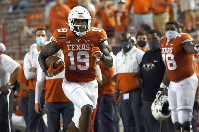 Texas' Malcolm Epps (19) runs for a long gain after a catch against UTEP during the second half of an NCAA college football game in Austin, Texas, Saturday, Sept. 12, 2020. (AP Photo/Chuck Burton)