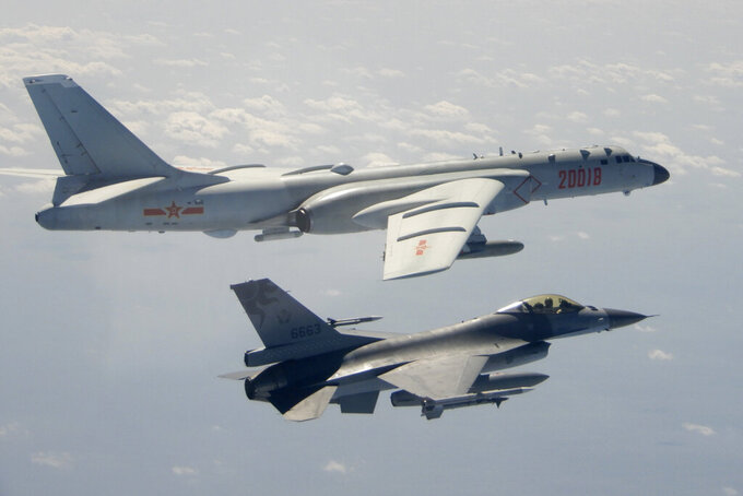 FILE - In this Feb. 10, 2020, file photo and released by the Republic of China (ROC) Ministry of National Defense, a Taiwanese Air Force F-16 in foreground flies on the flank of a Chinese People's Liberation Army Air Force (PLAAF) H-6 bomber as it passes near Taiwan. This year's annual congress meeting comes as China and the U.S. are attempting to soften the caustic tone in relations that prevailed during the Trump administration. While President Joe Biden is maintaining pressure over trade and technology, he has shown a willingness to restore dialogue. However, China has not shown any willingness to budge in the face of U.S. support for Taiwan and criticism of Beijing's policies in Hong Kong, Tibet and Xinjiang. (Republic of China (ROC) Ministry of National Defense via AP, File)