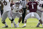Mississippi State running back Kylin Hill (8) looks to run against Texas A&M during the first half of an NCAA college football game, Saturday, Oct. 26, 2019, in College Station, Texas. (AP Photo/Sam Craft)