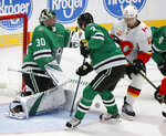 Dallas Stars goaltender Ben Bishop (30) shops a shot by Calgary Flames center Mikael Backlund (11) as Stars' John Klingberg (3) defends during the second period of an NHL hockey game in Dallas, Thursday, Oct. 10, 2019. (AP Photo/Michael Ainsworth)