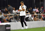 Inter Miami coach Phil Neville walks along the sideline during the first half of the team's MLS soccer match against the New England Revolution on Wednesday, July 21, 2021 in Fort Lauderdale, Fla. (AP Photo/Jim Rassol)
