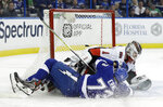 Tampa Bay Lightning left wing Adam Erne (73) crashes into Ottawa Senators goaltender Mike Condon (1) during the second period of an NHL hockey game Tuesday, March 13, 2018, in Tampa, Fla. (AP Photo/Chris O'Meara)