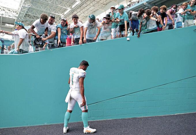 Miami Dolphins quarterback Tua Tagovailoa (1) walks out the fields after loss to the Atlanta Falcons in an NFL football game against the Atlanta Falcons, Sunday, Oct. 24, 2021, in Miami Gardens, Fla. (David Santiago/Miami Herald via AP)