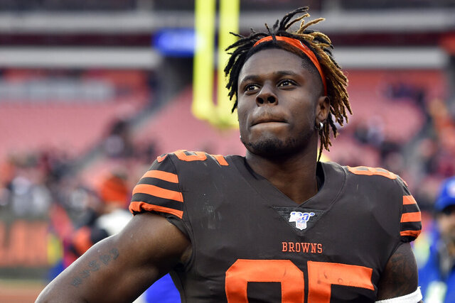 FILE - In this Dec. 8, 2019, file photo, Cleveland Browns tight end David Njoku walks off the field after an NFL football game against the Cincinnati Bengals in Cleveland. After demanding a trade last month, Njoku seemed to indicate on Saturday, Aug. 1, 2020, that he's changed his mind. The 2017 first-round draft pick tweeted,