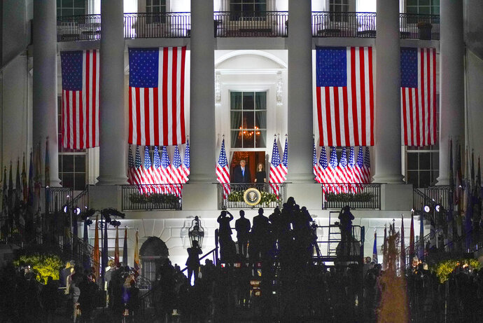 President Donald Trump and Amy Coney Barrett stand on the Blue Room Balcony after Supreme Court Justice Clarence Thomas administered her the Constitutional Oath on the South Lawn of the White House in Washington, Monday, Oct. 26, 2020. (AP Photo/Carolyn Kaster)