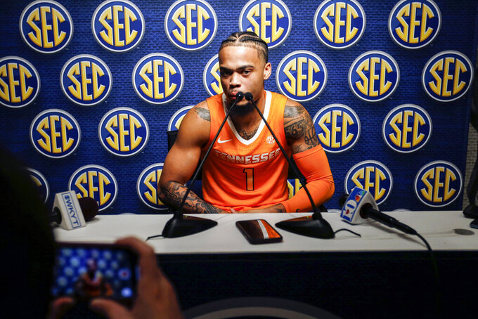 Tennessee's Lamonte Turner speaks during the Southeastern Conference NCAA college basketball media day, Wednesday, Oct. 16, 2019, in Birmingham, Ala. (AP Photo/Butch Dill)