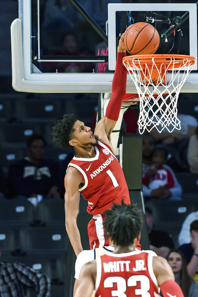 Arkansas guard Isaiah Joe (1) dunks in the first half of an NCAA college basketball game against Georgia Tech Monday, Nov. 25, 2019, in Atlanta. (AP Photo/Danny Karnik)