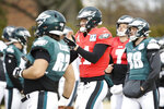 Philadelphia Eagles quarterback Carson Wentz, center, gathers with his teammates at the NFL football team's practice facility in Philadelphia, Thursday, Dec. 5, 2019. (AP Photo/Matt Rourke)