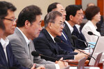 South Korean President Moon Jae-in, third from left, speaks during a Cabinet meeting at the presidential Blue House in Seoul, South Korea, Thursday, Aug. 29, 2019. Moon has berated Japan for carrying out its plan to downgrade South Korea's trade status and reiterated Seoul's stance that Tokyo was weaponizing trade to retaliate over political rows stemming from the countries' wartime history. (Han Sang-kyun/Yonhap via AP)