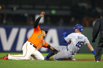 San Francisco Giants second baseman Donovan Solano (7) puts the tag on Los Angeles Dodgers' Matt Beaty (45) on an attempted steal of second base during the ninth inning of a baseball game Friday, May 21, 2021, in San Francisco. (AP Photo/D. Ross Cameron)