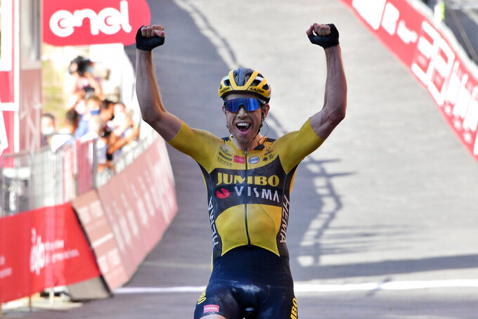 "Belgium's Wout Van Aert celebrates after winning the ""Strade Bianche"" cycling race from Siena to Siena, Italy, Saturday, Aug. 1, 2020. (Gian Mattia D'Alberto/LaPresse via AP)"
