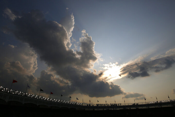 A clearing sky appears over Yankee Stadium after a rain storm moved through clearing a haze of smoke before a baseball game between the Philadelphia Phillies and the New York Yankees, Wednesday, July 21, 2021, in New York. Wildfires in the American West, including one burning in Oregon that's currently the largest in the U.S., are creating hazy skies as far away as New York as the massive infernos spew smoke and ash into the air in columns up to six miles high. (AP Photo/Adam Hunger)