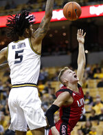 Incarnate Word's Drew Lutz, right, throws up a shot as Missouri's Mitchell Smith (5) defends during the first half of an NCAA college basketball game Wednesday, Nov. 6, 2019, in Columbia, Mo. (AP Photo/Jeff Roberson)