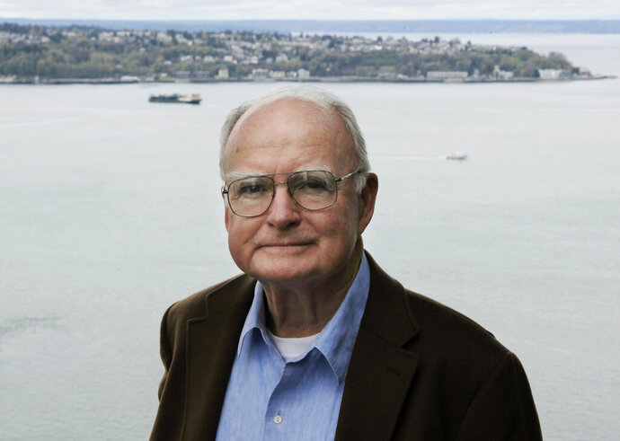 In this April 13, 2009, photo, William Ruckelshaus, the first administrator of the EPA, poses for photos at his office in Seattle. Ruckelshaus, who famously quit his job in the Justice Department rather than carry out President Richard Nixon's order to fire the special prosecutor investigating the Watergate scandal, has died. He was 87. The EPA confirmed his death in a statement Wednesday, Nov. 27, 2019. (AP Photo/Ted S. Warren)