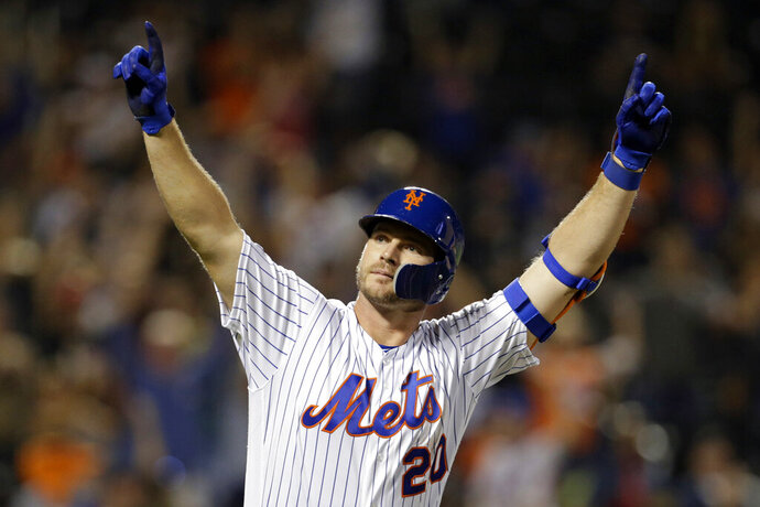 FILE - In this Sept. 28, 2019, file photo, New York Mets' Pete Alonso reacts after hitting his 53rd home run of the season during the third inning of a baseball game against the Atlanta Braves in New York. Alonso clubbed a rookie-record 53 homers and the Mets finished only three games out of a playoff spot last season following a big second half. (AP Photo/Adam Hunger, File)