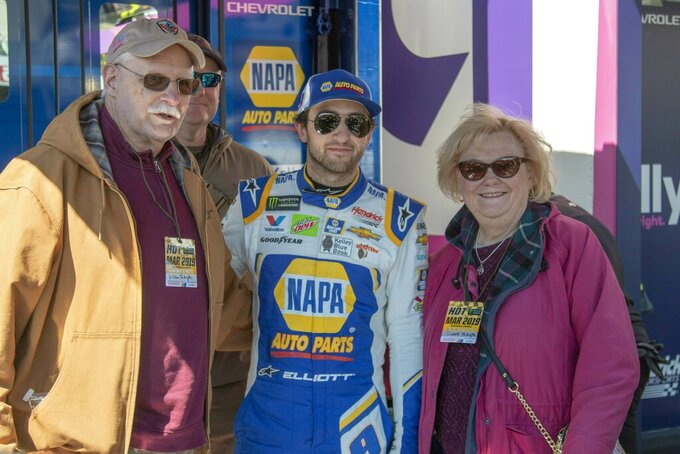 Chase Elliott met with race fans Steve Tarkington, Shawn Tarkington, and Betty Tarkington after practice for the NASCAR Monster Energy Cup Series race at Martinsville Speedway in Martinsville, Va., Saturday, March 23, 2019. (AP Photo/Matt Bell)