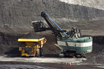 FILE - In this April 4, 2013 file photo, a mechanized shovel loads coal onto a haul truck at the Cloud Peak Energy's Spring Creek mine near Decker, Mont. A judge threw out a lawsuit on Friday, May 22, 2020, from a coalition of states, environmental groups and American Indians which sought to revive an Obama-era moratorium against U.S. government coal sales on public lands in the West. U.S. District Judge Brian Morris said President Donald Trump's administration had fixed its initial failure to consider the environmental impacts of ending the moratorium. (AP Photo/Matthew Brown, File)